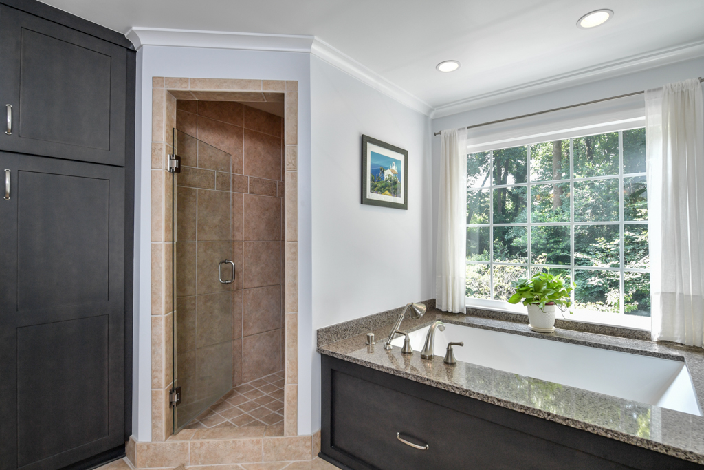 Master bathroom soaking bubble bath and walk-in shower with bench