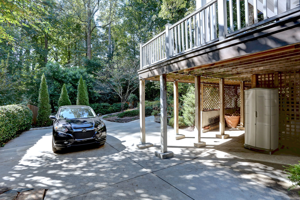 Parking to rear plus under-deck garden storage area