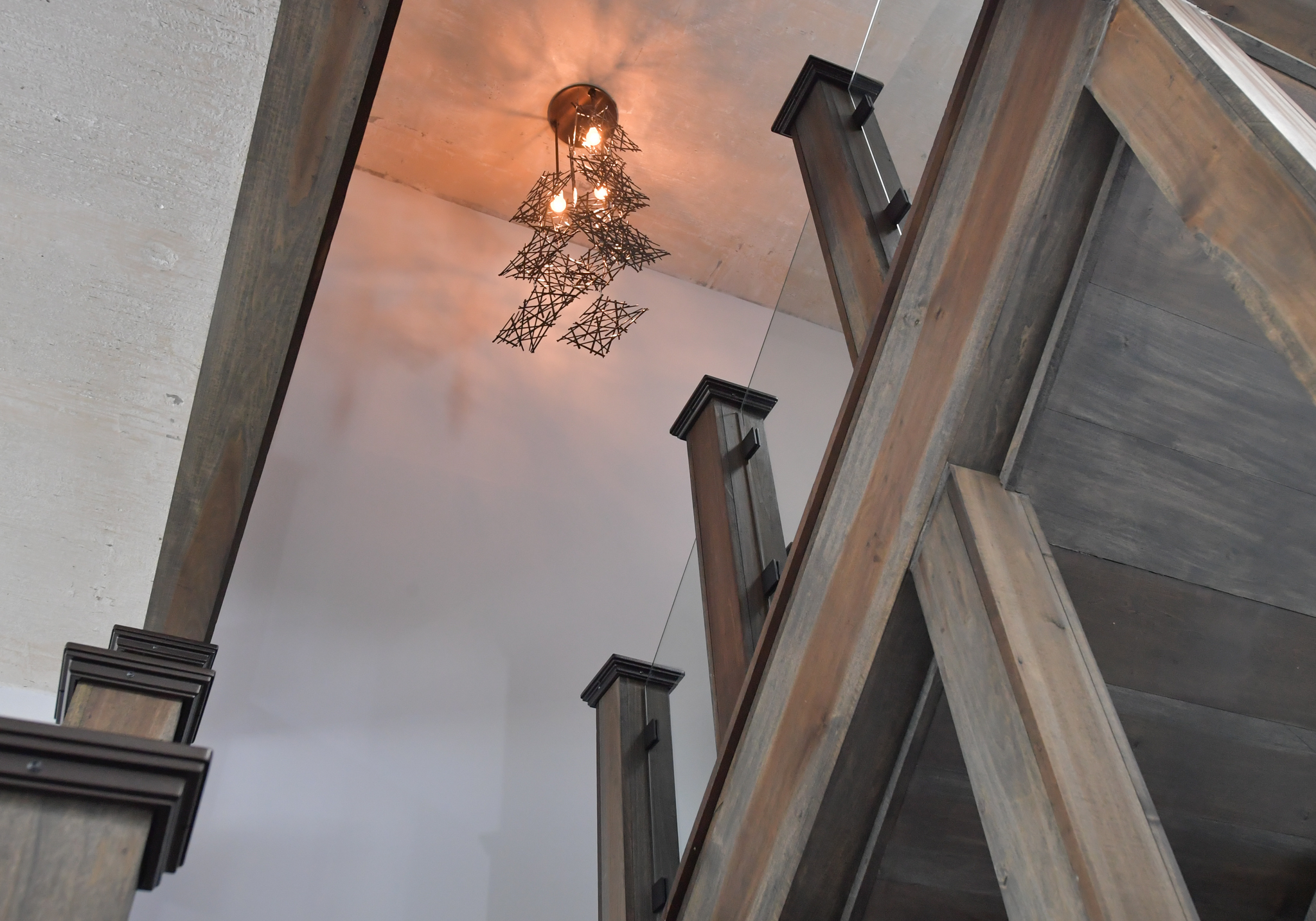 Light fixture ties into main level finishes