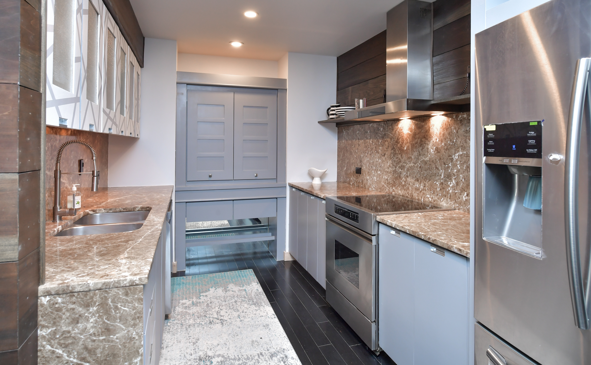 Renovated kitchen. Stainless appliances.